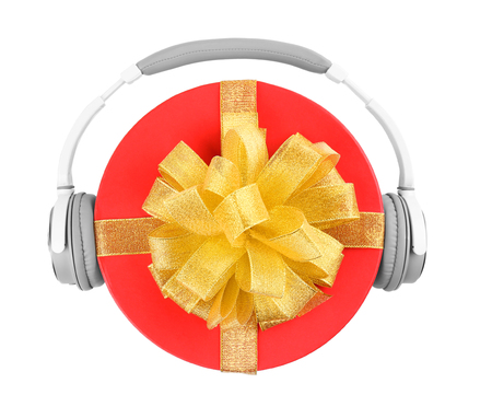 Christmas music concept. Gift with headphones, isolated on white background Stock Photo