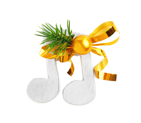 Christmas music concept. Decorative notes with bow, isolated on white background Stock Photo