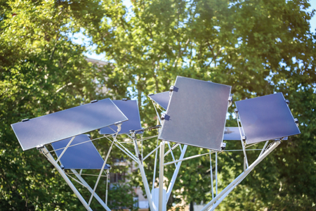 Solar panel tree on city street 스톡 콘텐츠