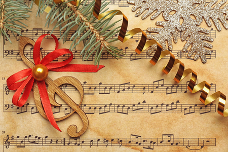Beautiful composition with decorations on music sheet. Christmas songs concept Фото со стока - 110987420