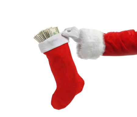 Santa Claus holding stocking with money on white background
