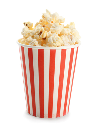 Paper cup with popcorn on white background