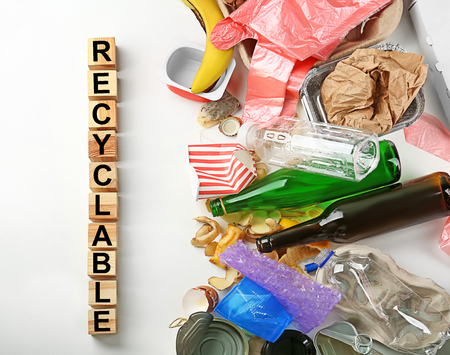 Composition with garbage and word Recyclable on white background Archivio Fotografico