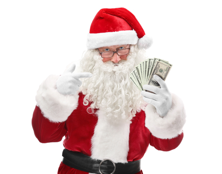 Santa Claus holding money on white background Stock Photo