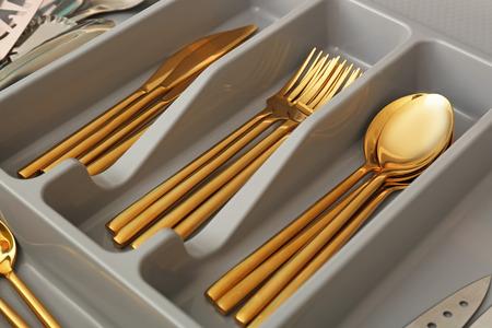 Cutlery in kitchen drawer, closeup