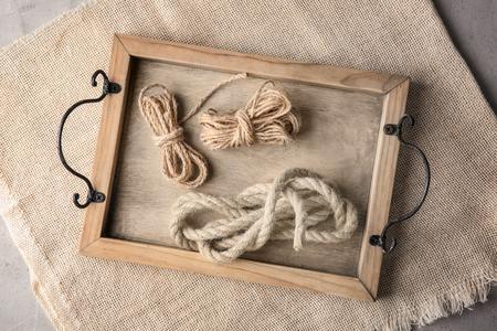 Hemp ropes on wooden tray