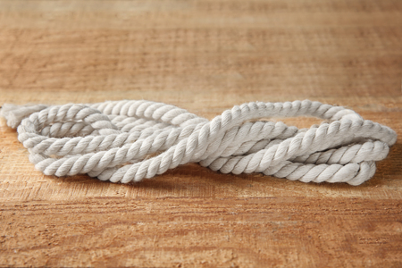 Hemp rope on wooden background