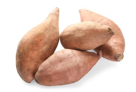 Sweet potatoes on white background Фото со стока