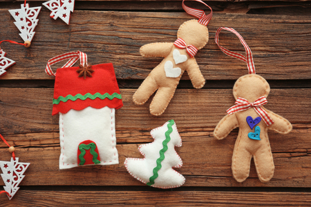 Christmas composition with soft toys on wooden background Imagens