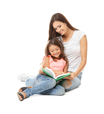Cute little girl with mother on white background Imagens