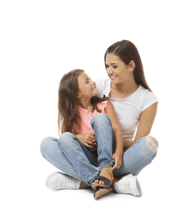 Cute little girl with mother on white background 免版税图像