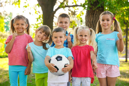 Cute little children with ball in park Stock Photo