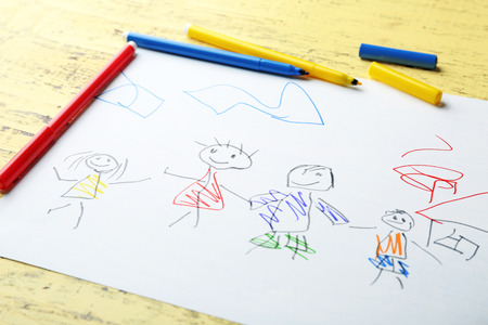 Child's drawing of family on table, closeup Reklamní fotografie