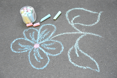 Chalk drawing of flower on asphalt