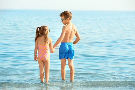 Cute little children on sea beach Imagens