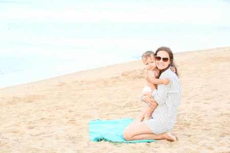 Happy mother with little son on beach Stok Fotoğraf