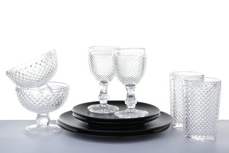 Glass and ceramic dishware on white background Banco de Imagens