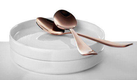 Ceramic dishware and spoons on white background Banco de Imagens