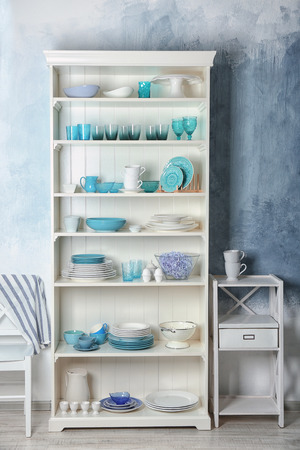 White storage stand with dishware in kitchen 写真素材 - 112193099