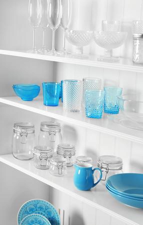 White storage stand with glassware in kitchen
