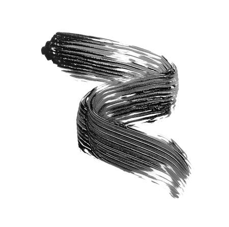 Trazo de pincel de rímel negro, aislado en blanco Foto de archivo