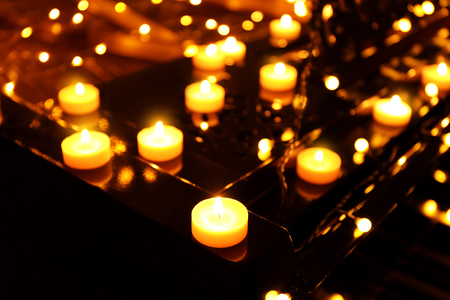 Piano with Christmas lights and candles, closeup Stock Photo