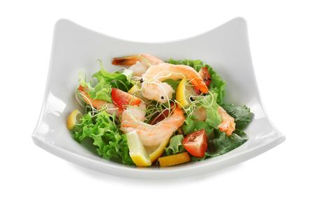 Plate with fresh tasty shrimp salad on white background