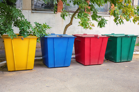 Recycling bins for different types of garbage outdoors Banco de Imagens