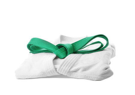 Karate uniform with green belt on white background Stockfoto
