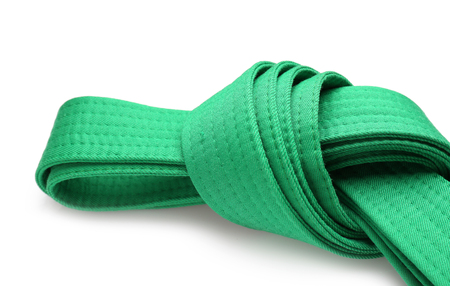 Green karate belt on white background