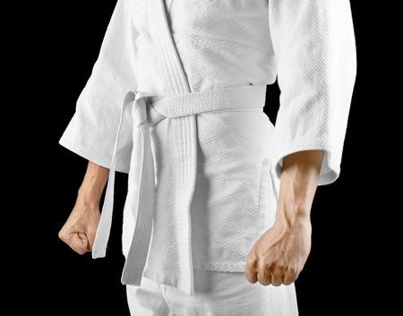 Man in karategi on dark background