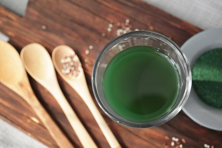 Glass with spirulina drink on wooden board Stock fotó