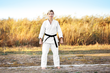 Female karate instructor outdoors Banco de Imagens