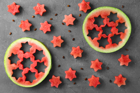 Stars made of watermelon on color background 스톡 콘텐츠