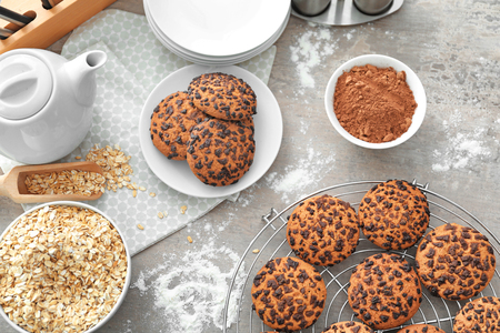 Composition with chocolate chip oatmeal cookies on table Archivio Fotografico