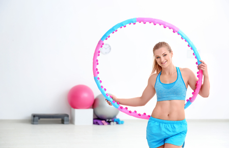 Woman with hula hoop in gym Banque d'images