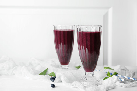 Glasses with acai juice on table