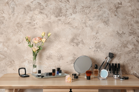 Cosmetic set on wooden dressing table