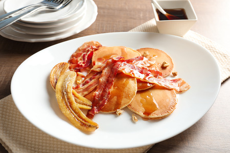 Tasty pancakes with bacon and banana on table Banque d'images