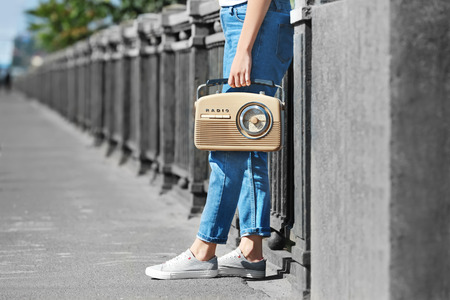 Woman holding radio, outdoors Banque d'images - 112743855