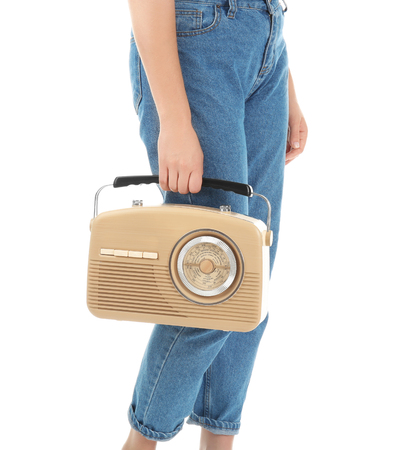Woman holding radio on white background Reklamní fotografie