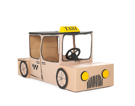 Cardboard taxi on white background