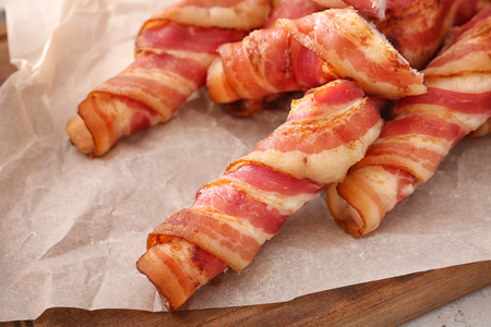 Bacon wrapped chicken nuggets on parchment Stock fotó