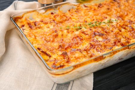 Delicious potato casserole in baking dish on table Imagens