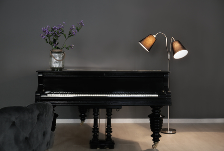 Modern room design with vintage piano