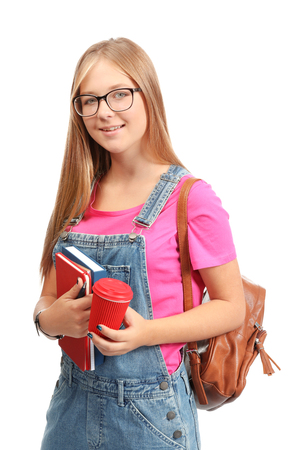 Pretty student with cup of coffee and copybooks on white background