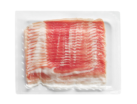 Raw rashers of bacon in package, isolated on white Stockfoto