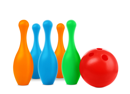 Toy bowling ball and pins on white background Stockfoto