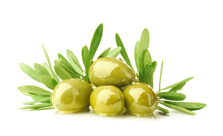 Green canned olives with leaves on white background Stock fotó