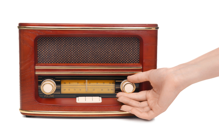 Hand of young woman with retro radio receiver on white background Reklamní fotografie